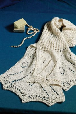 Donna Druchunas's lovely scarf includes several of the motifs from Cousin Martha's shawl (see preceding article), including the border and the mesh design. Photograph by Joe Coca.