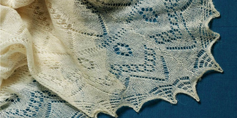 Lace: The beautiful and intricately knitted shawl that was passed down to the author's cousin. The family is trying to determine who knitted the shawl. The author's great-great- grandmother Martha Moore Thomas Morris is one possibility. About 64 x 63 inches (162.6 x 160.0 cm). Photograph by Joe Coca.