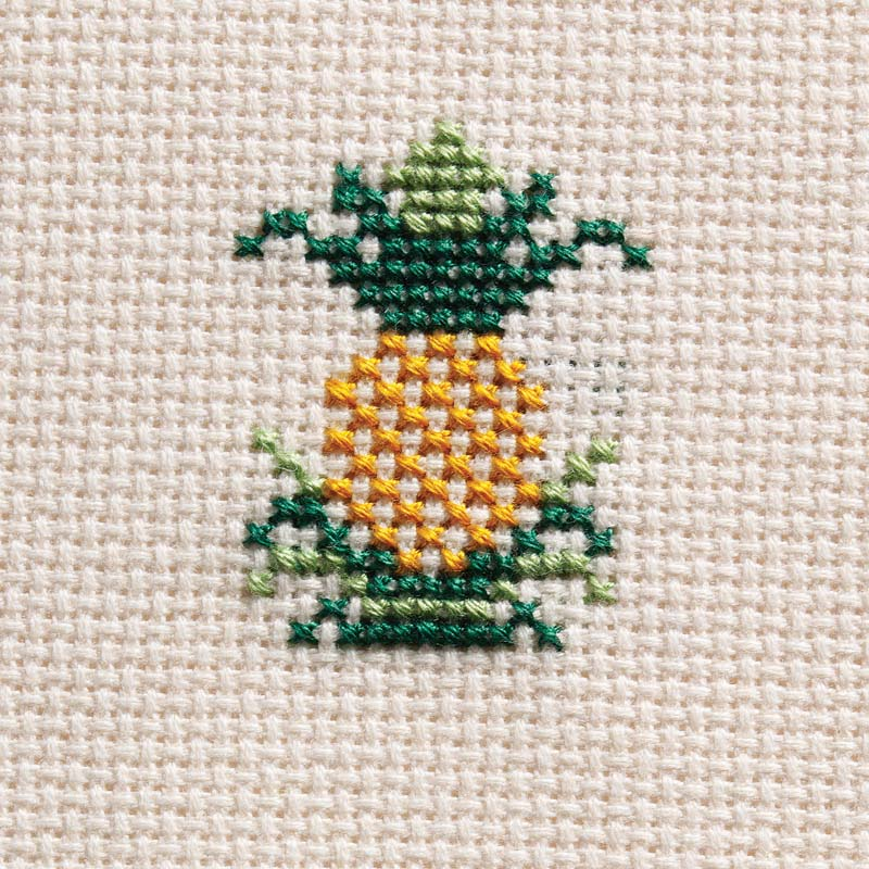 Patricia Phillips's pineapple is worked in cross-stitch with two strands of cotton floss on 18-count Zweigart Davossa evenweave fabric.