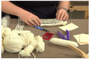 Abby shows how to measure yarn for a large project.