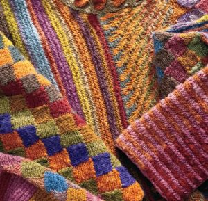 Using the inherent energy of singles yarns, many colors, and a variety of knit stitches as creative tools, Kathryn Alexander creates awe-inspiring artistic garments.