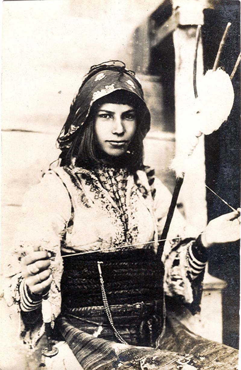The culture of spindle and distaff interweave a 1916 postcard shows a young woman in balkan costume holding a spindle and distaff sciox Gallery