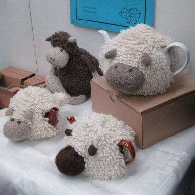 Hand-spun, hand-knitted sheep tea cozies