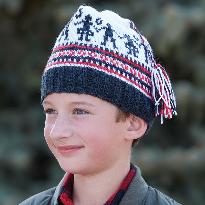 "Susan Strawn's knitted cap ""Norwegian Barnelue to Knit"" will delight the younger set. The dancing couple plus the stripes and tiny geometric patterns are traditional Norwegian motifs. Photograph by George Boe."