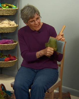 Maggie Casey loads her handcard.