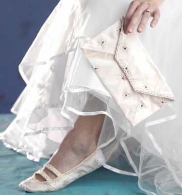 Embroidered and sewn wedding shoes and keepsake envelope. Photo by Joe Coca.