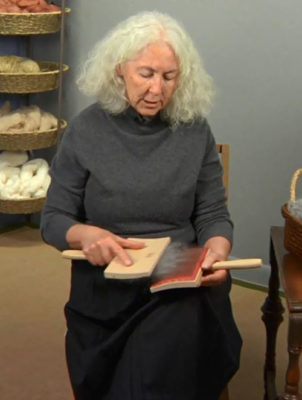Carol Huebscher Rhoades demonstrates how to hold handcards.