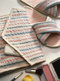 Handwoven seersucker cosmetic bag and slippers by Barbara Eychaner