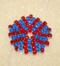 Learn how to do a circular flat peyote stitch in this expert beading blog, step 11, the last step, includes adding one seed bead in each space between up beads as well as between each pair of beads added in the previous row.
