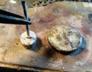 keep a coin with solder on your solder station