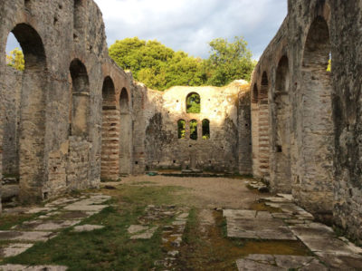 Butrint, Albania, a UNESCO World Heritage Centre that was—at different times—an ancient Greek colony, a Roman city, and a paleo-Christian bishopric. Mimi Seyferth purchased the original socks at a Butrint craft stall. Photo by Mimi Seyferth.