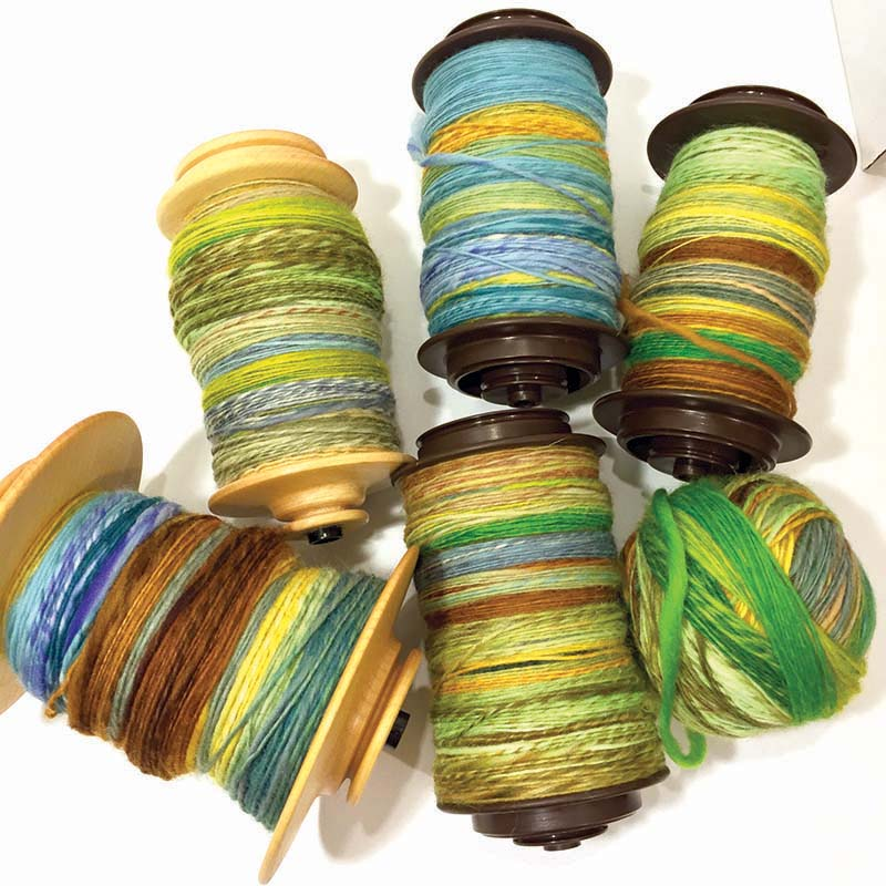 Spinalong: Spinning the singles for the #combospinsalkal used up every bobbin—and then some! Photo by Debbie Held