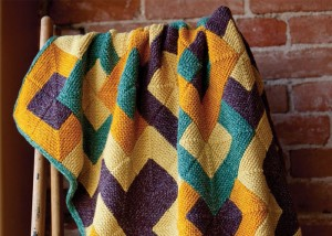 Learn how to make this mitered square knitting blanket pattern in our FREE eBook on projects for knitting blankets and afghans.