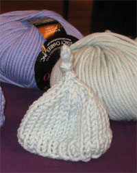Create these knitted preemie caps in this free guide on baby knitting patterns.