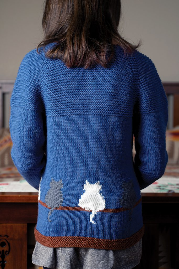 Window Cat Child's Cardigan designed by Jennifer Raymond from Love of Knitting Winter 2016