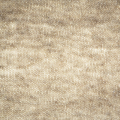 With light placed behind the knitted fabric, it's easier to see the yarn's consistency.