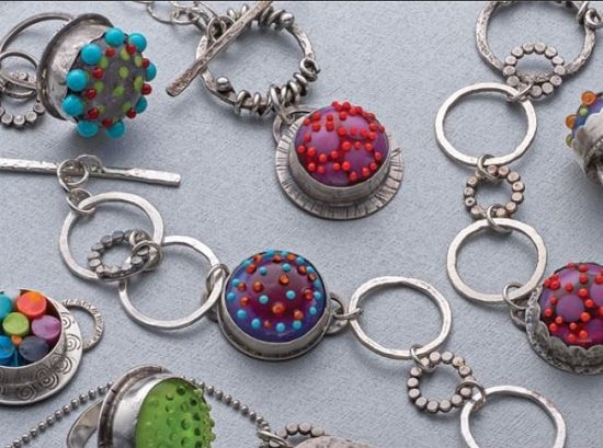 jewelry designs and lampworked cabochons by Cassie Donlen. Cassie created these using a micro-torch and butane fuel.
