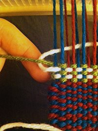 How to loop the active weft yarn around the inactive weft to smoothly cover the color change.