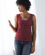 The Serene Box Pleat Top by Kristin Omdahl is aflattering top that has 5 motifs at the bust.