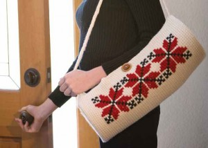 Learn how to make this crocheted bag patter with cross-stitch crochet embroidery in our FREE eBook on crochet embellishments.