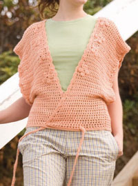 The Flora Kimono by Judith L. Swartz is a fun scaled-down crochet top pattern for women.