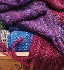 Learn how to knit a scarf with your scrap yarn in this free spinning eBook that contains 5 scarf knitting patterns.