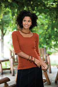 This Tunisian crochet sweater is slimming and stylish.