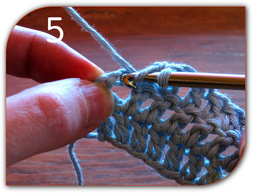 Double Crochet: Demonstrating how to put the hook into this chain.