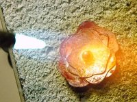 Metalsmithing jewelry: torch fire sterling silver flower ring pieces on firing brick