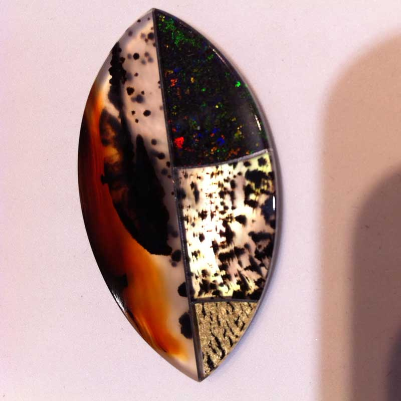 10+ Way Cool Cabochons from Around the World Seen in Tucson. marquise shaped cab includes pieces of Montana agate, some with gold run through a rolling mill to create the pattern, and Australian matrix opal by Steve Walters