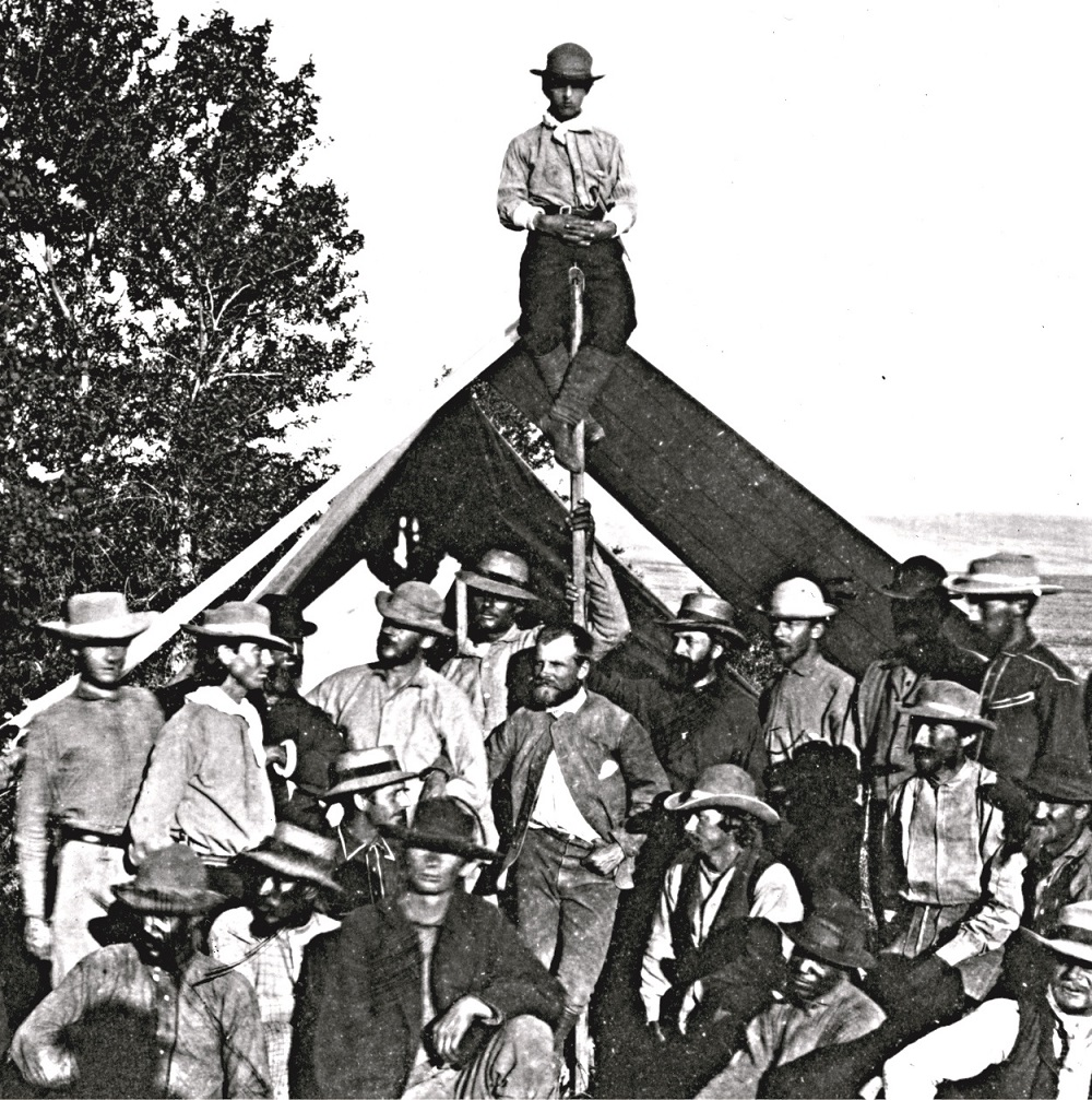 Part of the team that made the survey of the 40th parallel in 1867. King is in the center in front of the tent pole.