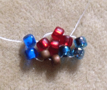 Learn how to cubic right-angle weave in this expert beading blog, step 4 includes adding two more beads and passing them through the nearest bead from the previous unit, the bead in the base at the beginning of this step and the first bead you added in this step.