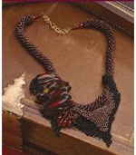 This fun beading rope necklace project can be found in the Beaded Ropes free eBook.
