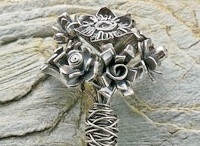 The Wire Wrapped Metal Clay Bouquet is made from the metal clay jewelry technique of quilling and can be found with step-by-step instructions in our free Metal Clay Jewelry eBook.
