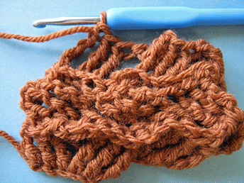 Edgeless Crochet Cables: Setting up the second cross of the third row.