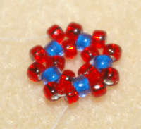 Learn how to do a circular flat peyote stitch in this expert beading blog, step 6 includes stepping up through the first pair of beads added and treating them as a single unit.
