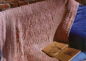 Learn how to knit this lace blanket found in our FREE eBook on knitting blankets and afghans.