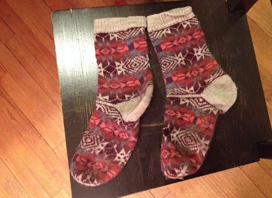 A well-loved pair of Fair Isle Socks. This is Lisa Shroyer's Bandelier knit socks pattern.