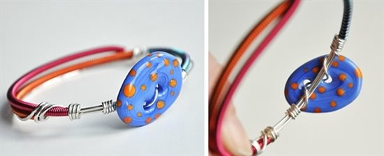 coiled wire bangle with lampwork glass button by Kerry Bogert