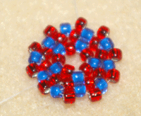 Learn how to do a circular flat peyote stitch in this expert beading blog, step 9 includes adding one bead in each space for the next round.