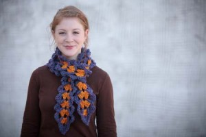 The Conch Scarf by Jodi Witt is a beginner crochet pattern that can be found in the 10 Free Crochet Scarf Patterns eBook.