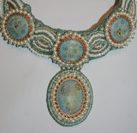 Here's an example of a beautiful bead embroidery project: Pearl Bead Embroidery Necklace.