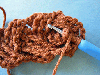 Edgeless Crochet Cables: Working behind stitches for first cross of third row (RS shown).