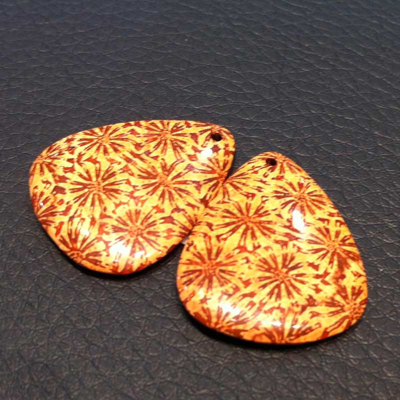 10+ Way Cool Cabochons from Around the World Seen in Tucson. Fossilized agate - agatized corals appear like flowers scattered across a gem's surface. Seen at Tarak at the Gem & Jewelry Exchange (GJX)