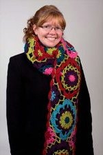 The Carmen's Jazz scarf is a crochet scarf pattern that is created by using colorful yarn.