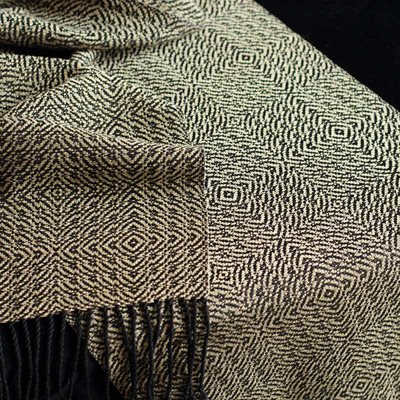 Unmercerized cotton and natural dyes give this handwoven scarf an elegant yet rustic look.