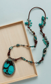 The Turquoise Collage by Marcella Austenfeld is a gemstone bead necklace project found in our free Gemstone Jewelry Projects eBook.