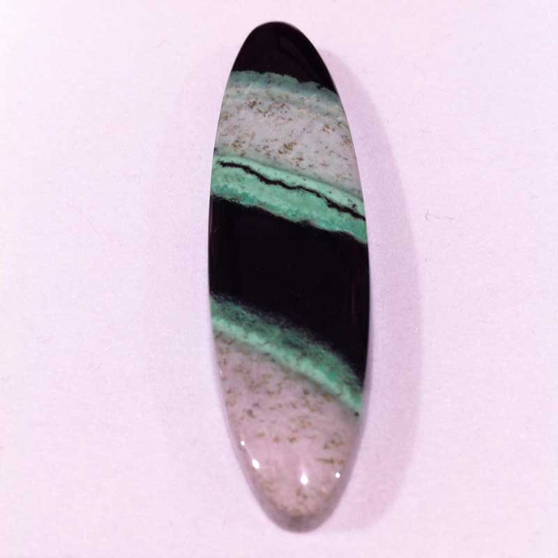 10+ Way Cool Cabochons from Around the World Seen in Tucson. At Donald K. Olson at the Gem & Jewelry Exchange, I saw this speckled white, bluish green, and black cabochon, also garnet (the black is chromite) from the Transvaal in northern South Africa