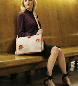 The Messenger Bag by Julie Armstrong Holetz is a fun crochet bag project to complete.