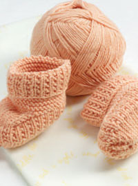 Create these Portuguese-style knitted baby booties in this free guide on baby knitting patterns.
